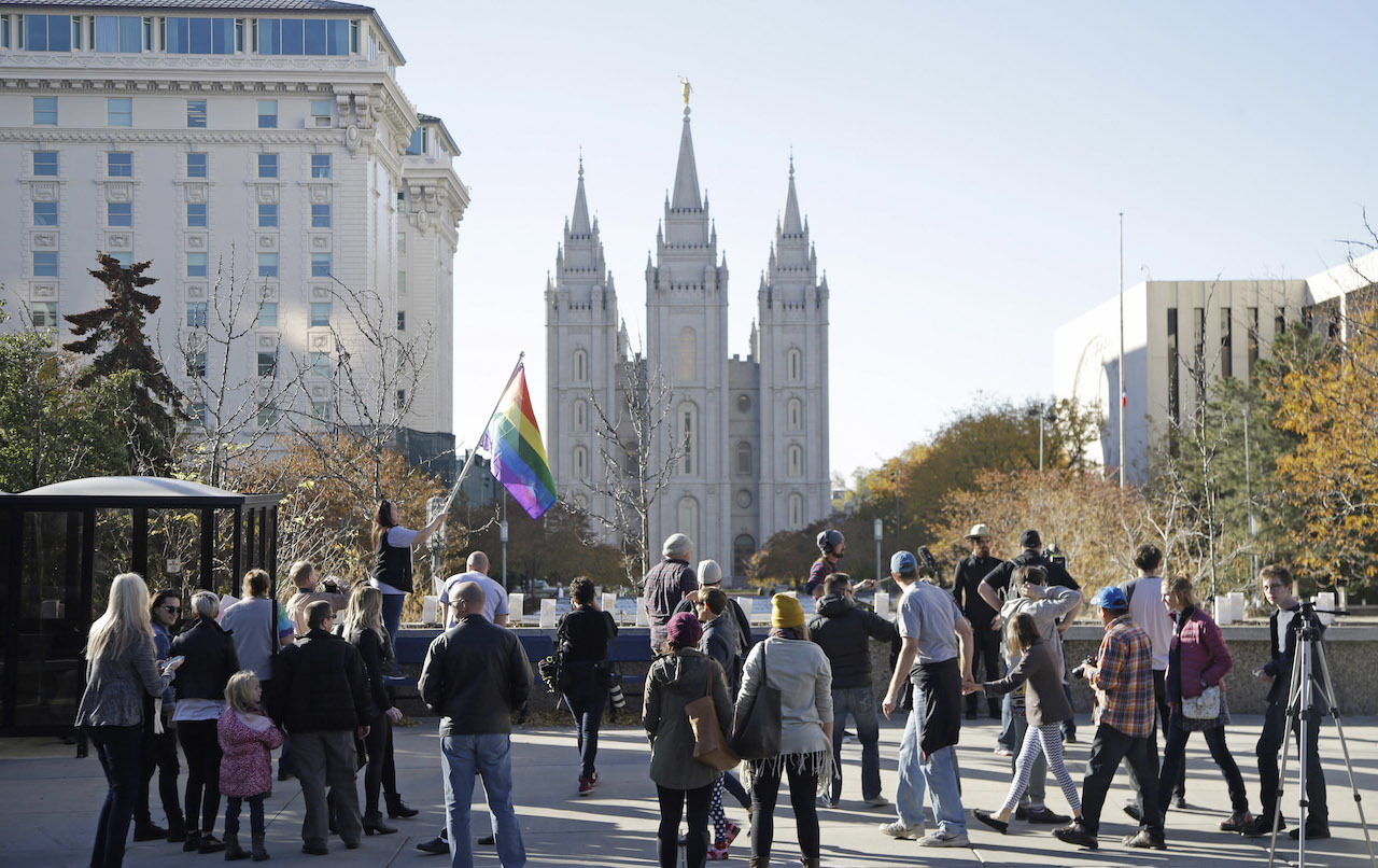 People walk past the Salt Lake Temple