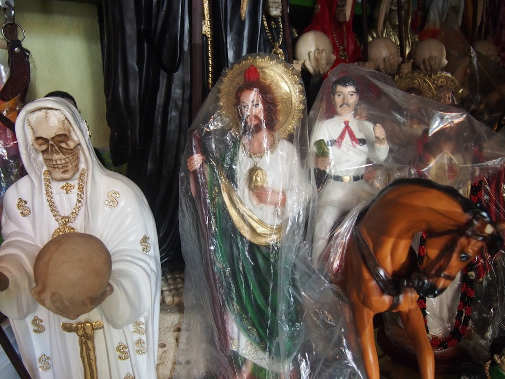 Statues of the Santa Muerte, San Judas Tadeo, and Jesús Malverde (L-R) being sold side by side in Culiacan, Sinaloa.
