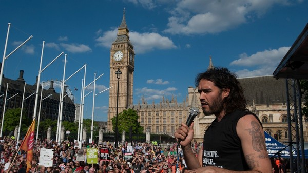 Russell Brand's Call for Peaceful Revolution Is Effortlessly Moronic