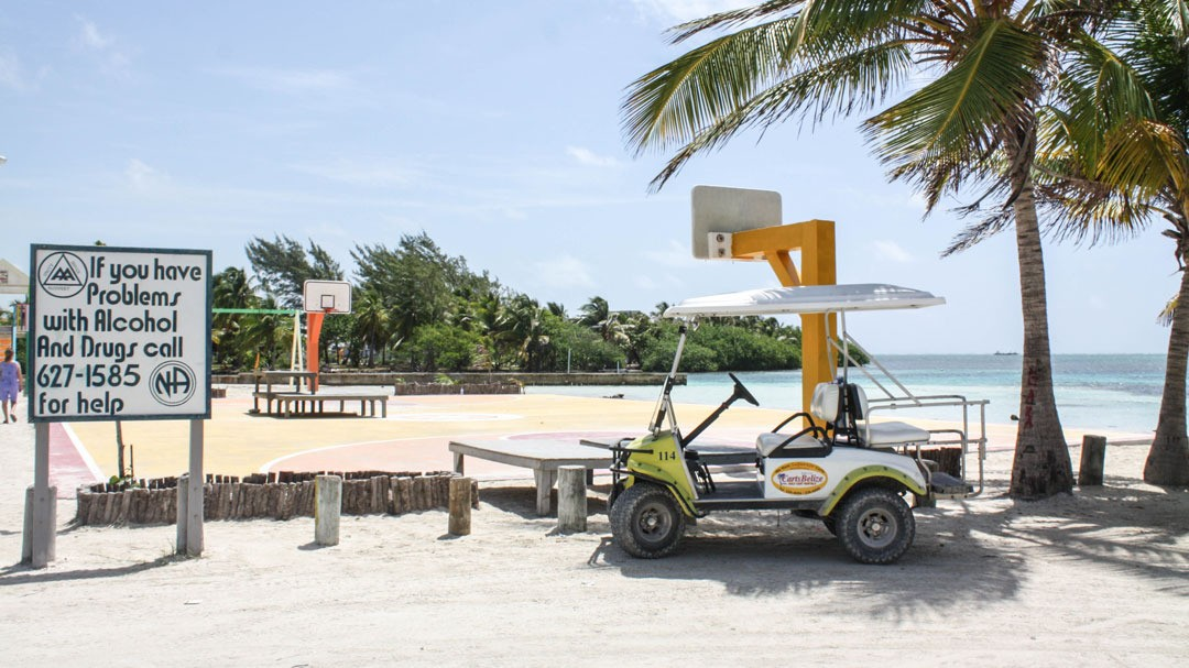 Belise Island Good Belize Island Image People Are Milling About A Snack Bar And Lounging On A