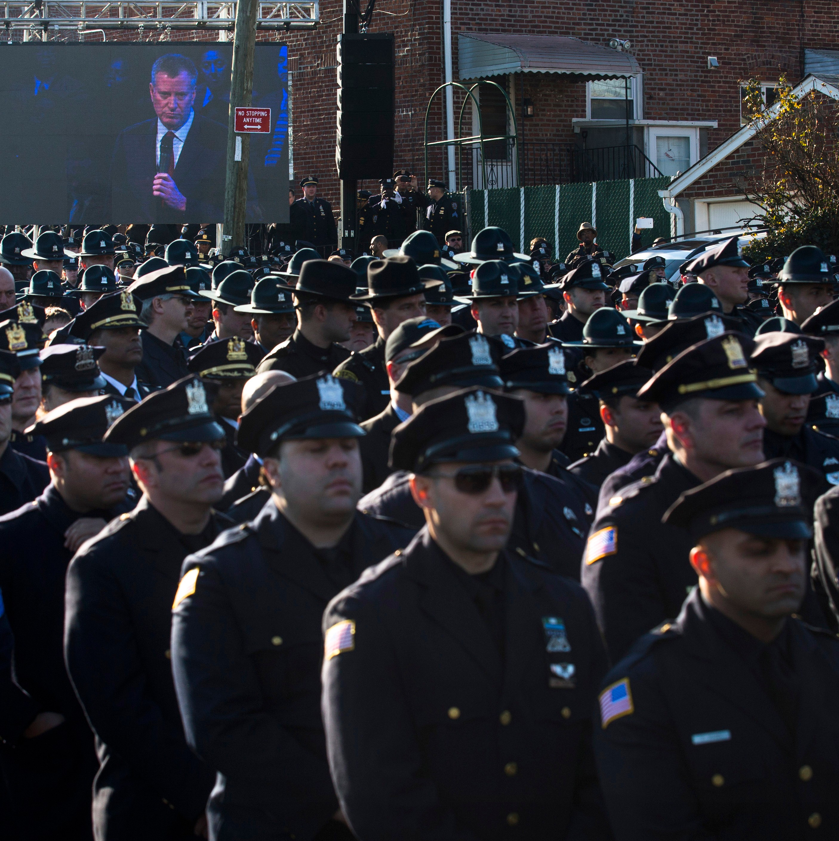 the cops who turned their backs at the nypd officer u0027s funeral are