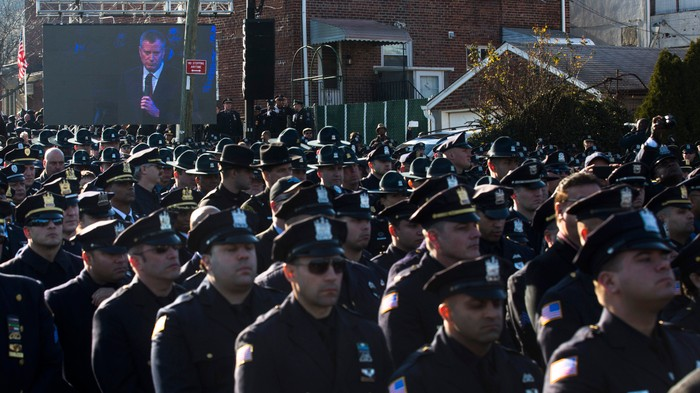 The Cops Who Turned Their Backs at the NYPD Officer's Funeral Are the Most Threatening Protesters Of All