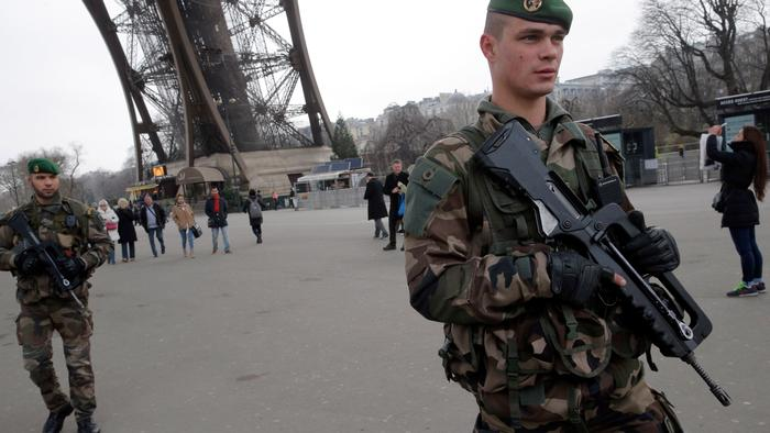 Troops Deployed in Paris to Hunt for Accomplices of Gunmen in Terror Attacks