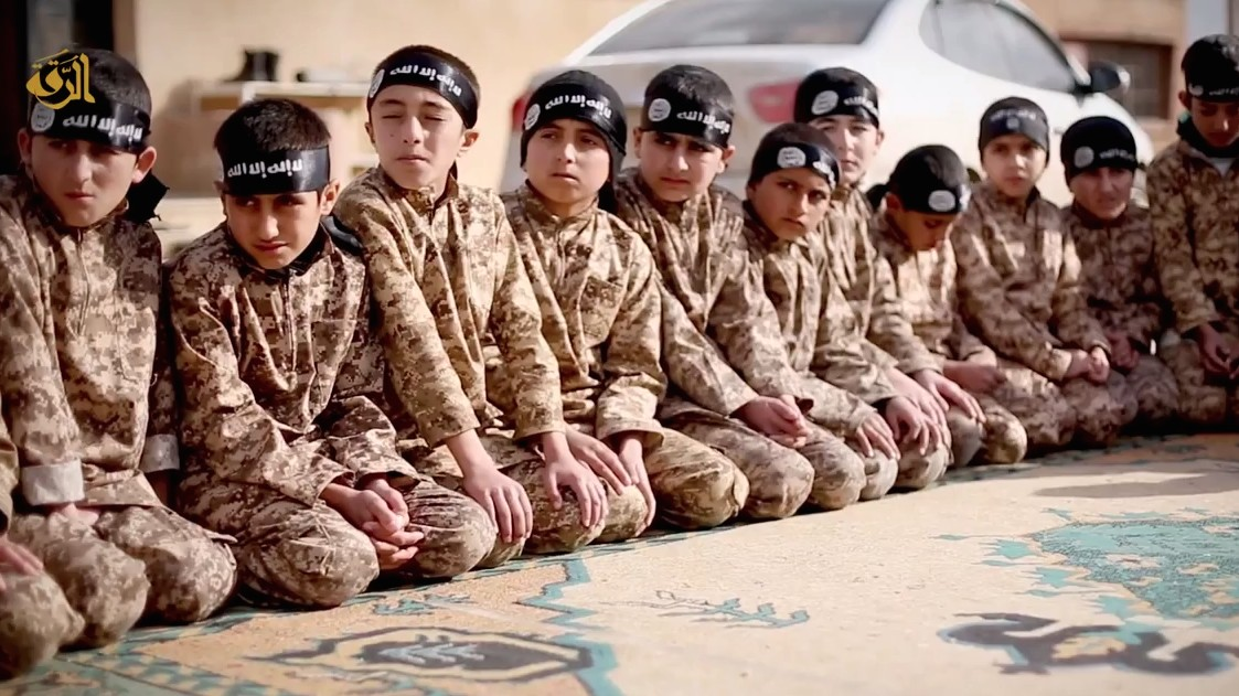 Islamic State Child Training Video Emerges as Reports of Its English Language Schools Circulate