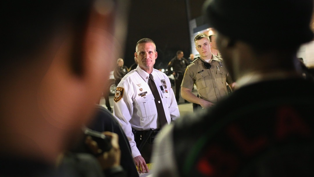 Police Charge Man With Shooting Cops in Ferguson