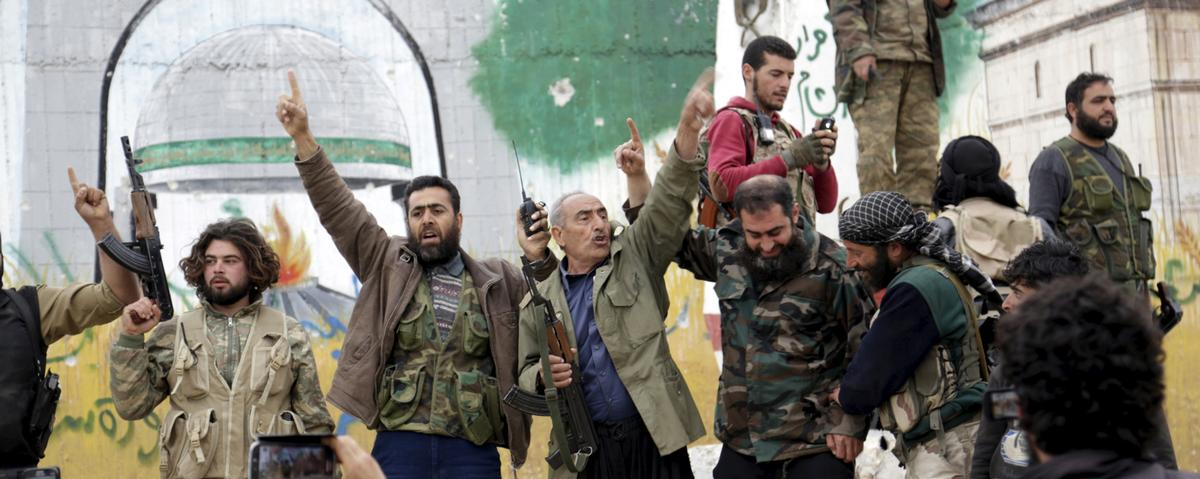 Videos Show Wild Celebration by Syrian Rebels After Takeover of City of Idlib