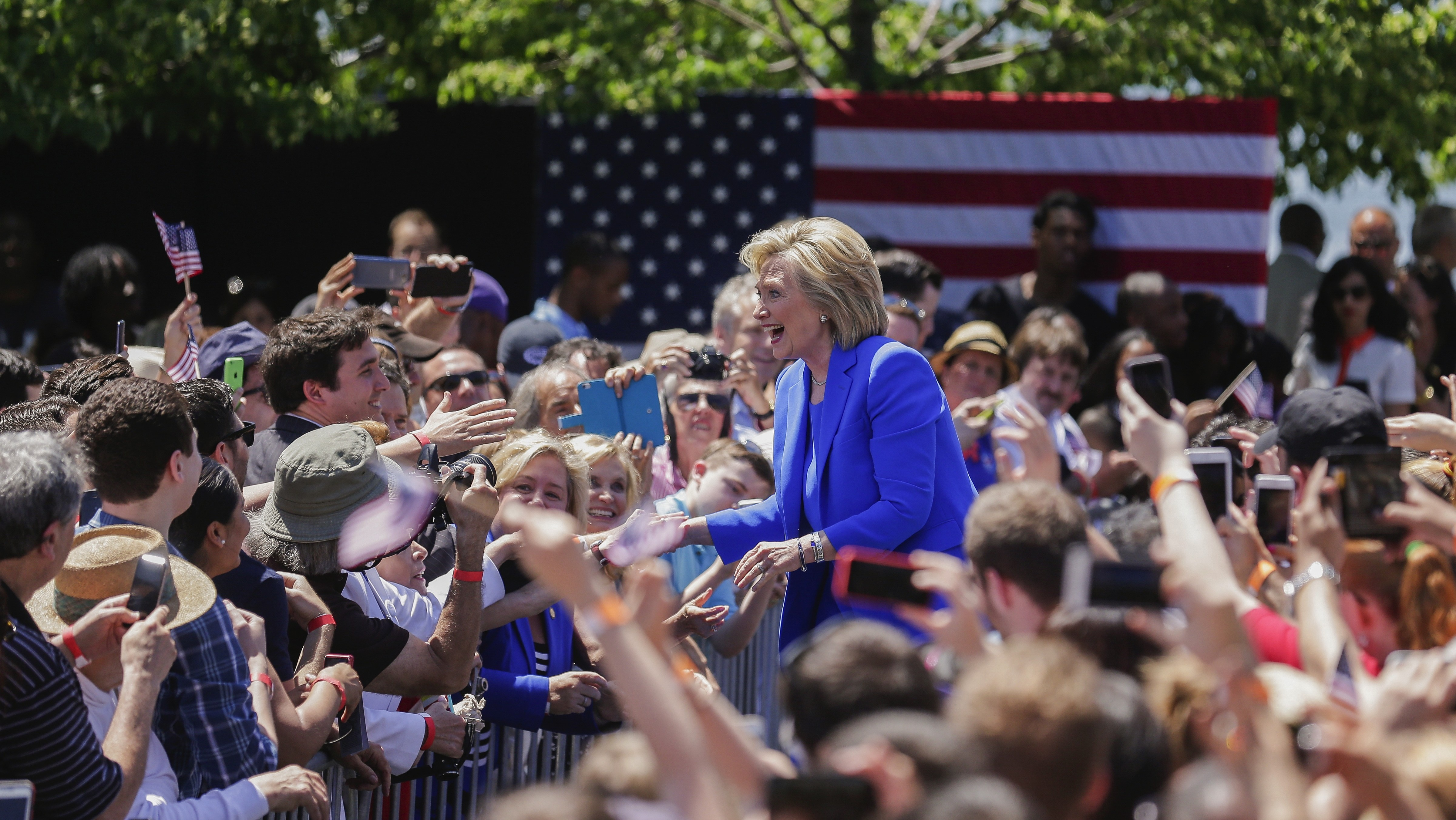 GOP Protesters Can't Kill the Buzz as Clinton Promises Prosperity at Campaign Rally