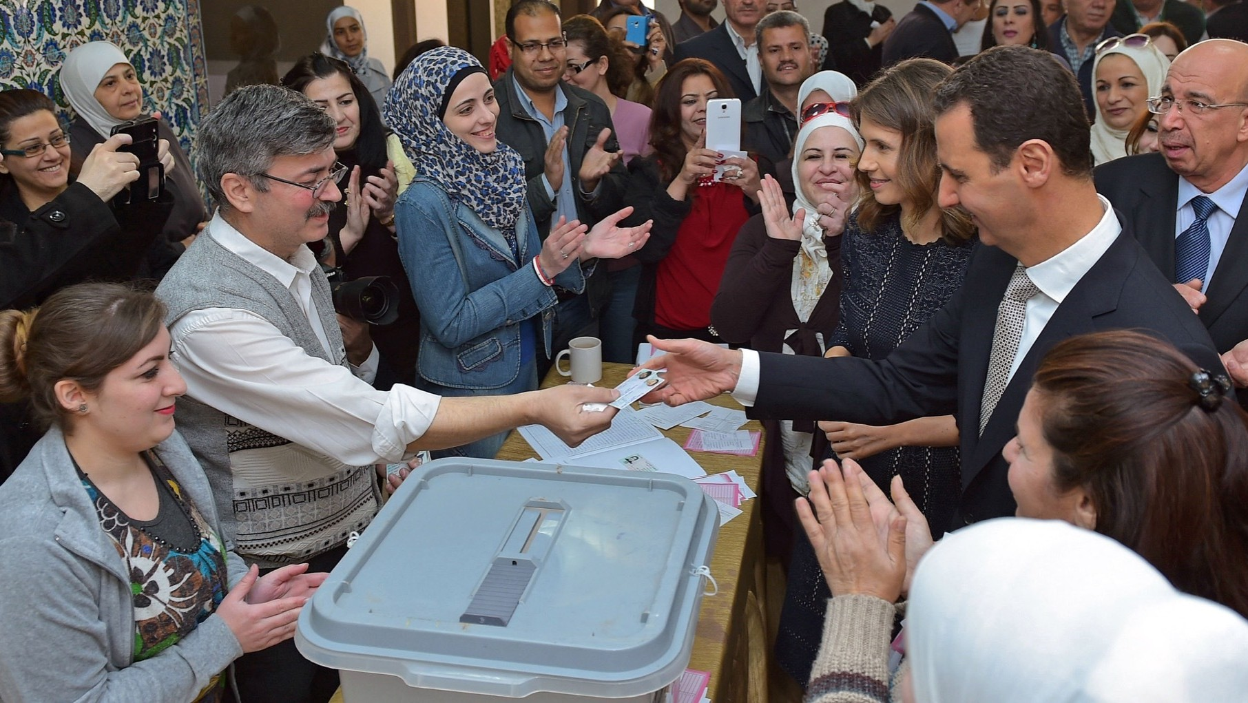 Syrians Vote in 'Sham' Election While UN-led Peace Talks Resume
