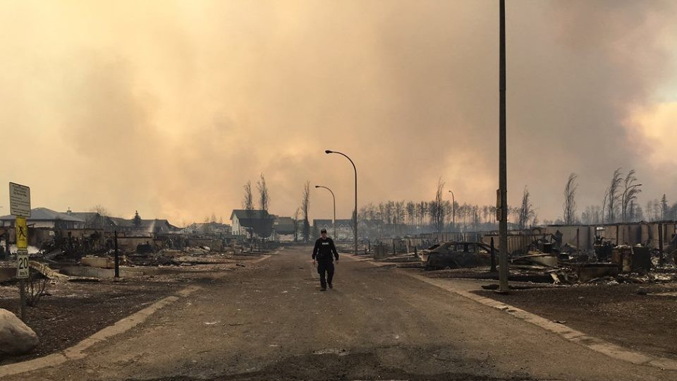 Convoy of Evacuees Now Moving Through a Devastated Fort McMurray as Wildfire Rages On