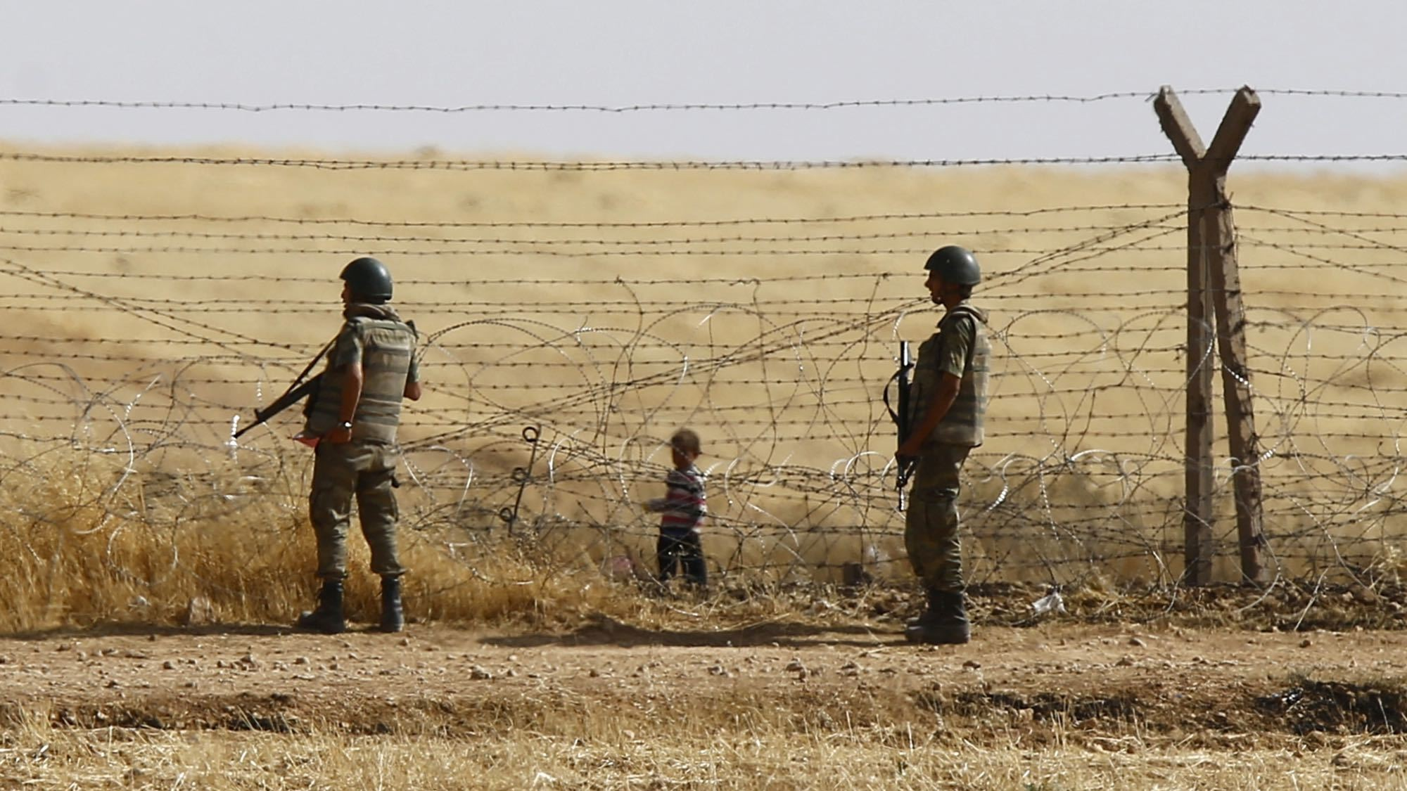 Turkish troops killed 7 adults and 4 children as they tried to flee Syria on Saturday