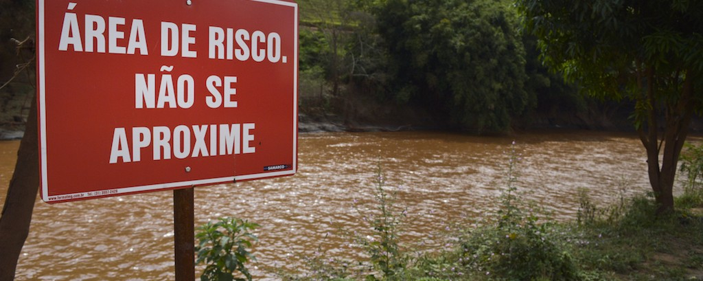 Brazil's Sweet River still runs orange seven months after a massive mining spill