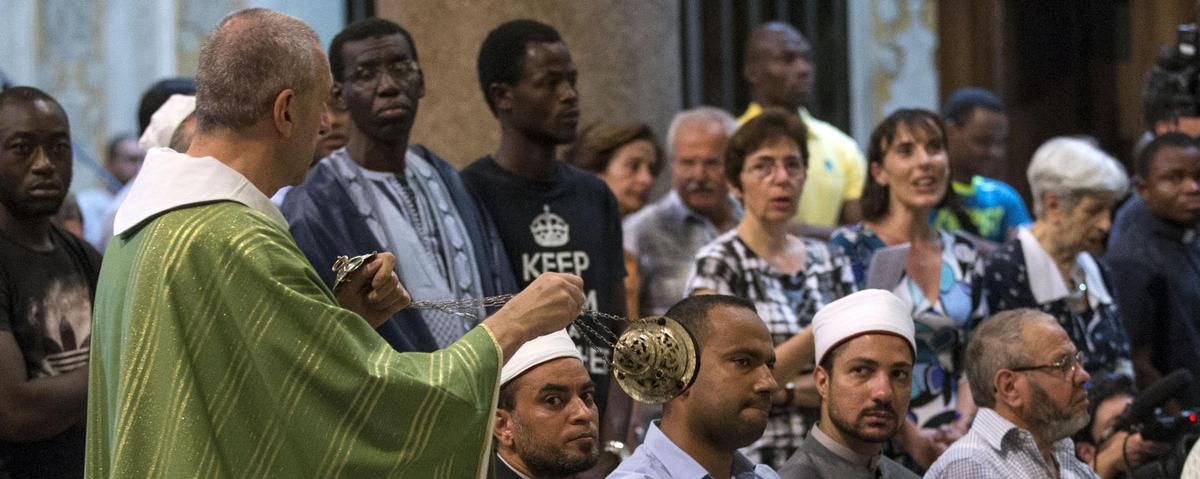 French Muslims attend Catholic Mass to show solidarity after the murder of a priest