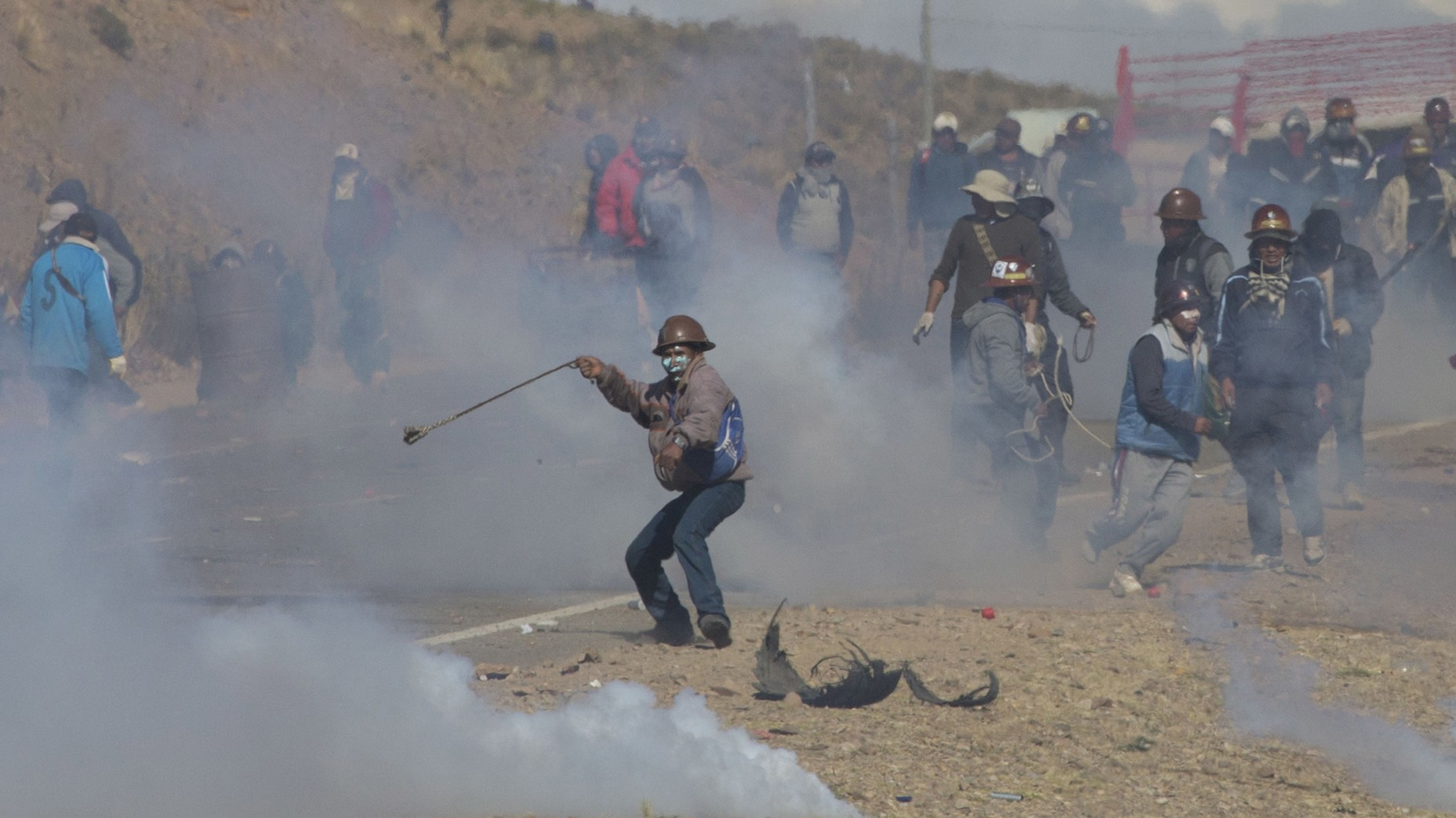 Striking Bolivian miners beat a deputy minister to death