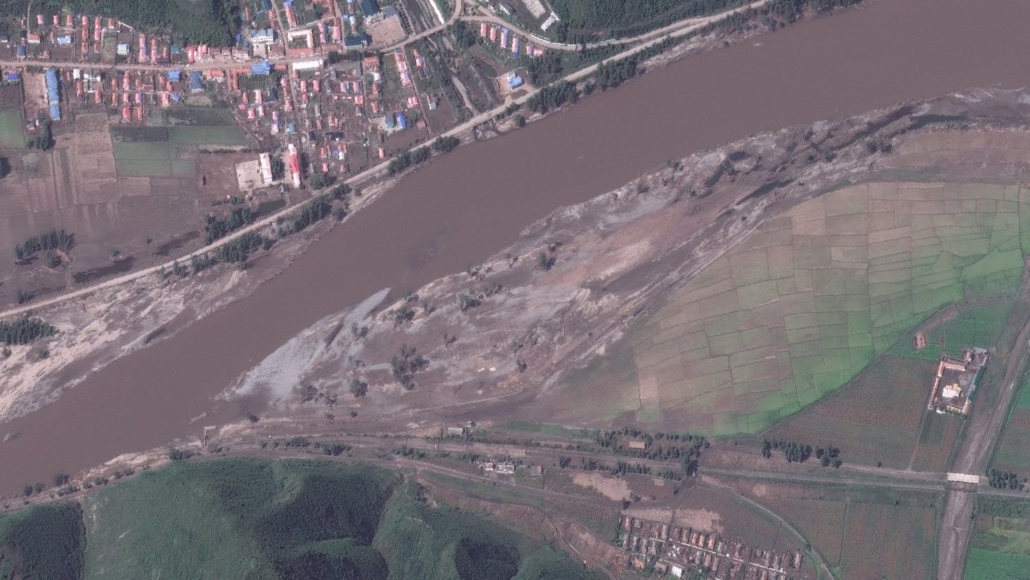Exclusive photos show the extent of flood devastation in North Korea