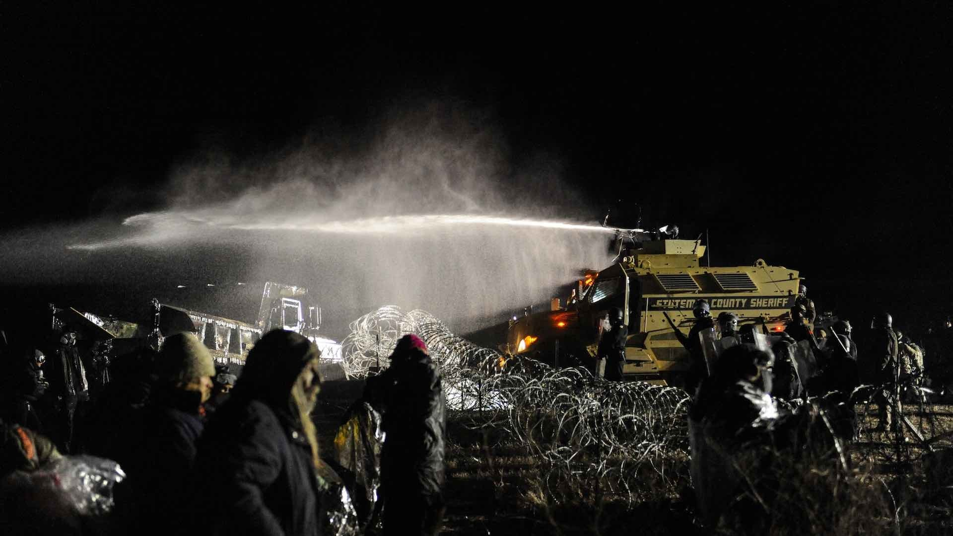 Police hit Standing Rock protestors with water cannons in freezing temperatures